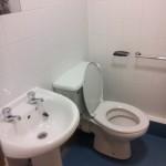 En-suite bathroom showing sink, toilet and towel rail. All bedrooms are en-suite.